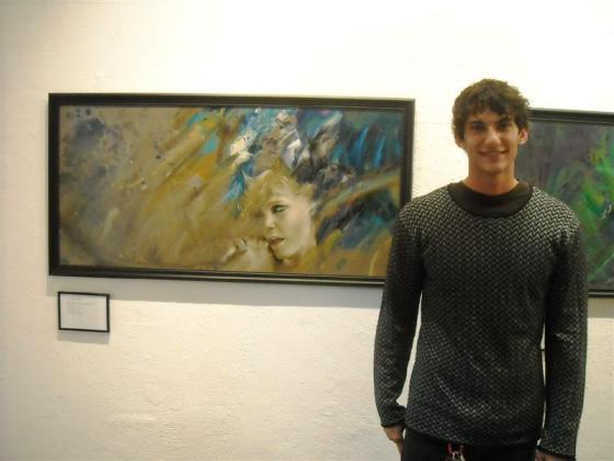 Natan DeYoung alongside his work