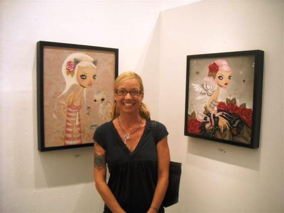 Caia Koopman alongside her work
