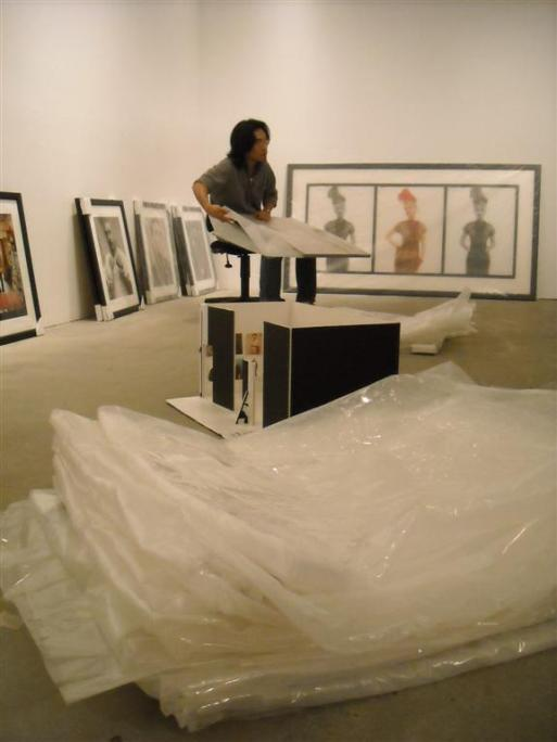 Roman Cho hard at work installing 'Heroes & Villains'