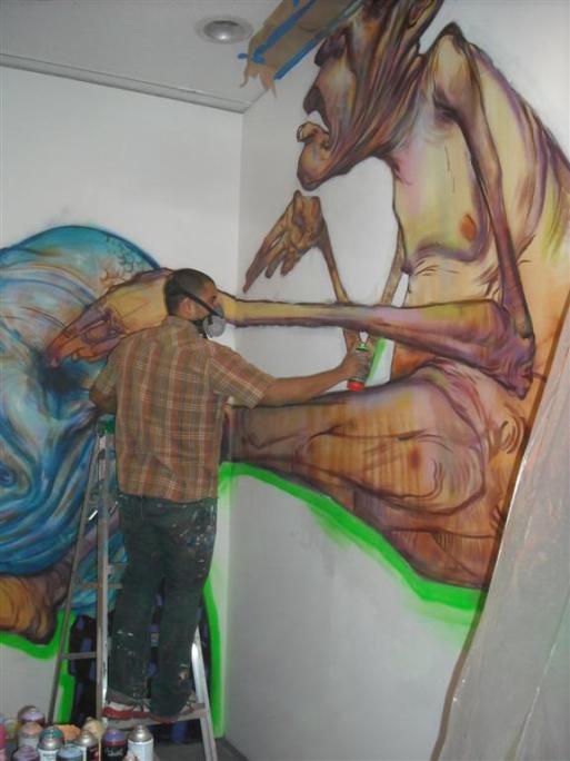 Ekundayo at work on his mural inside LAMAG