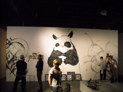 Sneak peek of the show coming together with murals from Kofie, Angry Woebots and Codak coming together