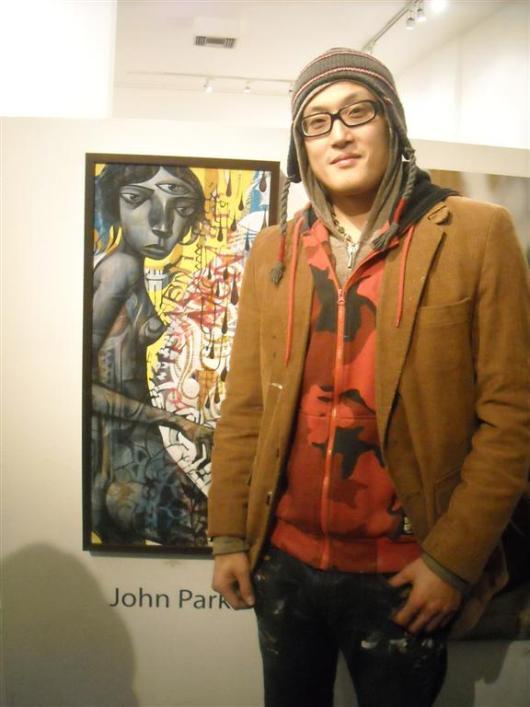 John Park alongside his work