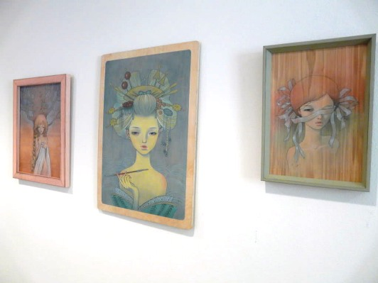 Wall of work from Audrey Kawasaki including 'Oiran' in the middle