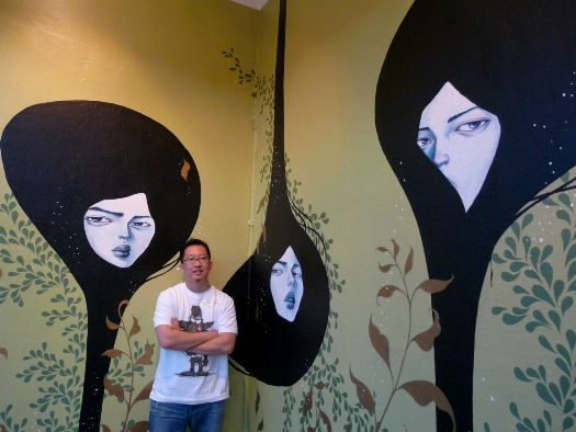 Collector Hung-Hei Yung alongside mural from Stella Im Hultberg